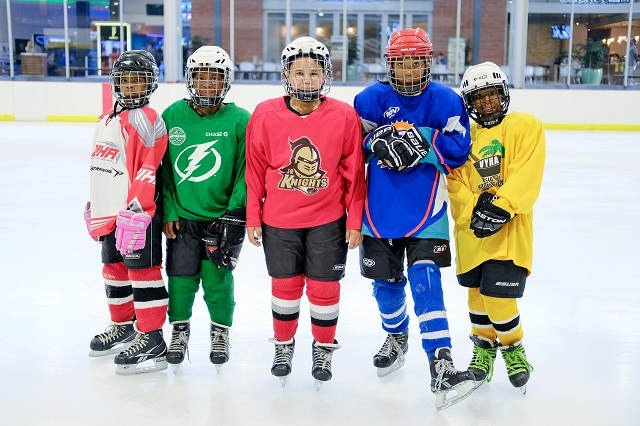 SOS kids in full equipment before hockey practice