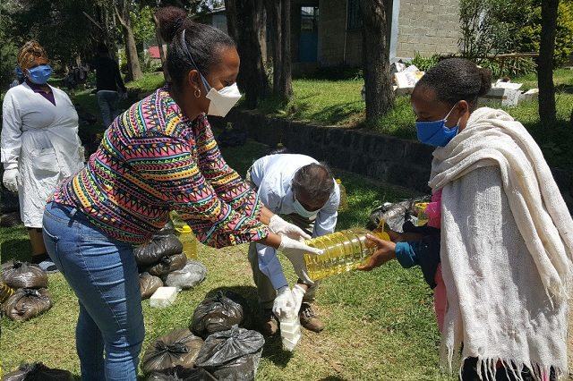 SOS workers distribute relief packages to needy recipients.