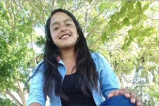 Maria* smiling.
