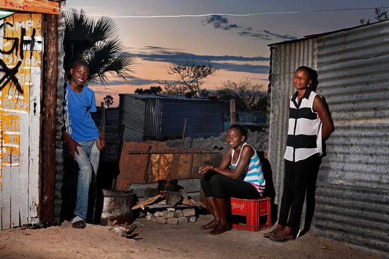Young mother with siblings at home in Ondangwa, Namibia.