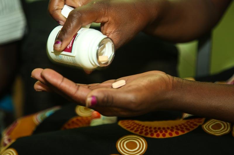 Taking medication in Kitwe, Zambia