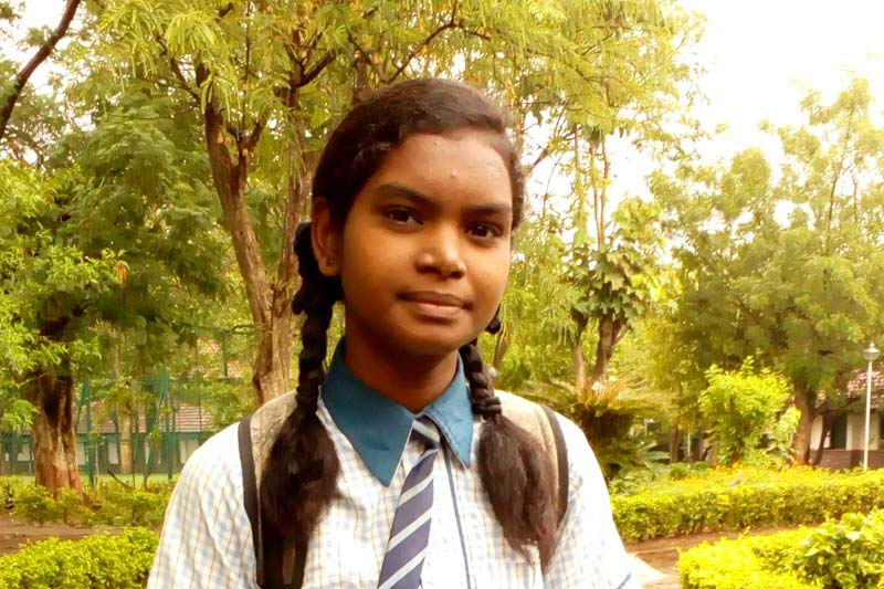 Girl in school uniform in India
