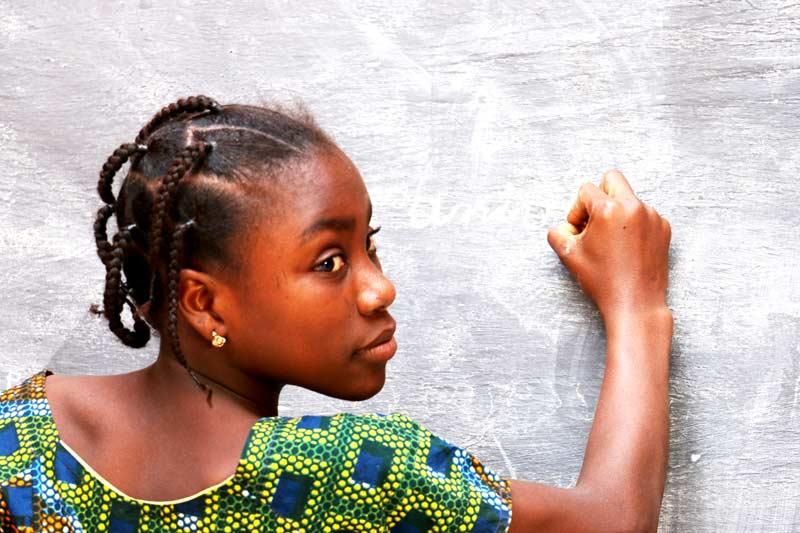 Girl writing on blackboard in Niger