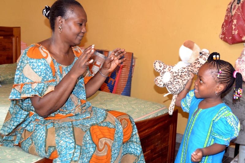 SOS mother with her daughter and stuffed jaguar in Senegal