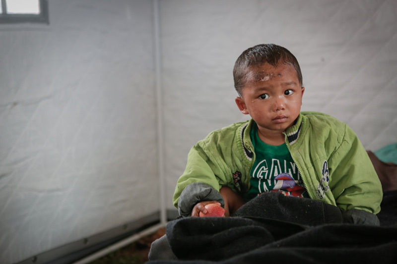 Boy in relief camp after Nepal earthquake
