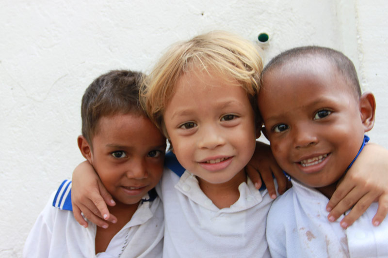 Three young boys at their kindergarten