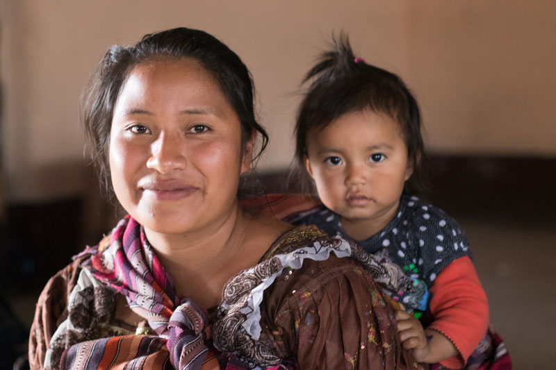 Woman carrying her baby, Guatemala