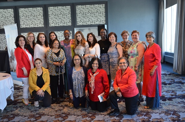 Olive Lumonya and the women of the High Tea event posing together.