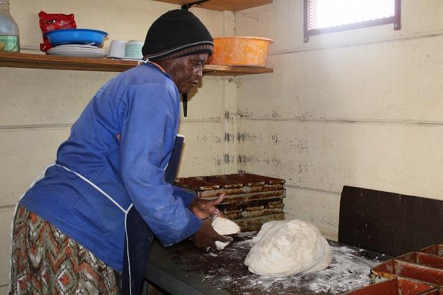 Wambi preparing a large ball of dough