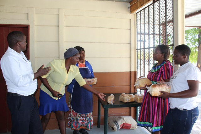Sanna and Wambi selling bread to customers
