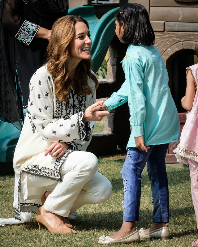 The Duchess of Cambridge greeting an SOS child.
