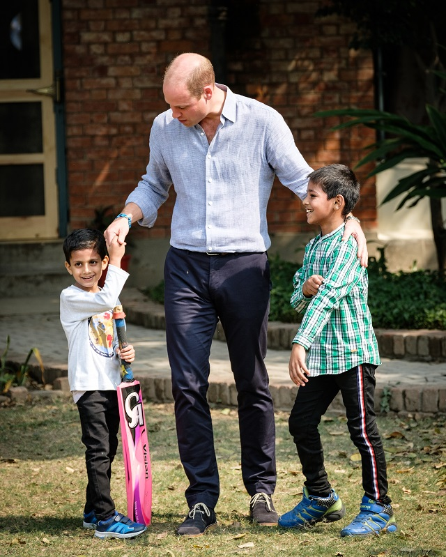 The Duke of Cambridge getting ready to play cricket with SOS children.