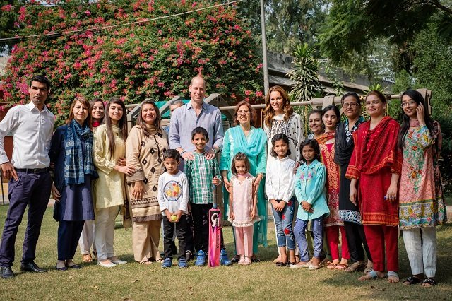 The Royal couple posing with staff and children from SOS Children's Villages Lahore.