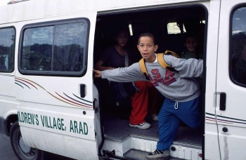 Boy getting off SOS school bus in Israel