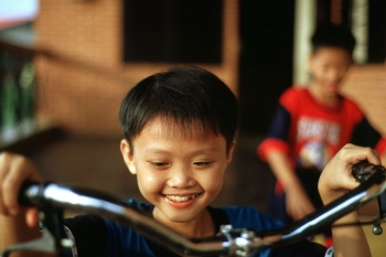 Sponsored boy sitting on a bicycle in Ben Tre, Vietnam