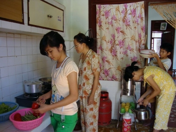 Children helping their SOS mother in the kitchen in Da Nang, Vietnam