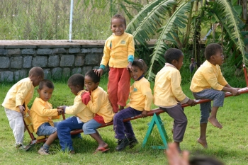 Children playing on see-saw in Antsirabe, Madagascar
