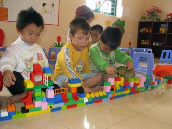 SOS sponsored children playing with Duplo in Dien Bien Phu, Vietnam
