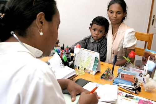 Doctober writing a prescription in the SOS Medical Centre in Antsirabe, Madagascar