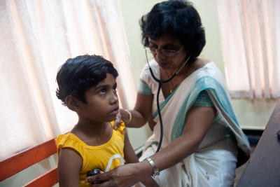 Sri Lankan sponsored child getting a checkup by a doctor in Piliyandala, Sri Lanka