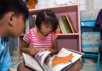 Sponsored child reading about geography in the SOS Village in Calbayog, Philippines