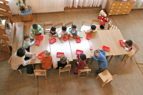 Kindergarteners sitting at a table in Cisnadie, Romania