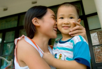 SOS siblings hugging in Hai Phong, Vietnam