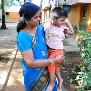 SOS mother holding a child in Chennai, India