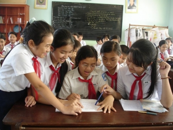 Students working together in school in Vinh, Vietnam