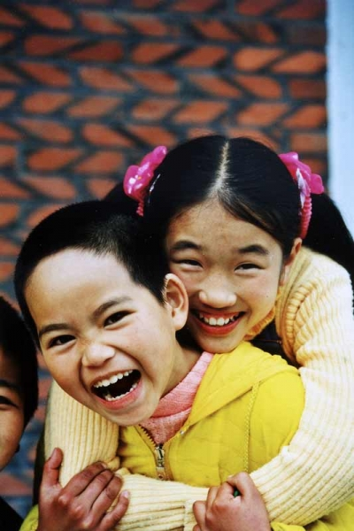 Two children laughing in Putian, China