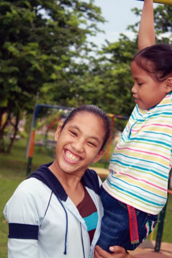 Sponsored youth holding her sister in Iloilo, Philippines