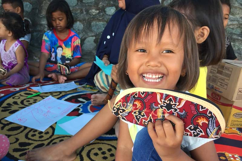 Smiling girl at SOS Child Friendly Space in Indonesia