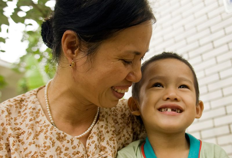 SOS mother and son smiling in Hanoi, Vietnam