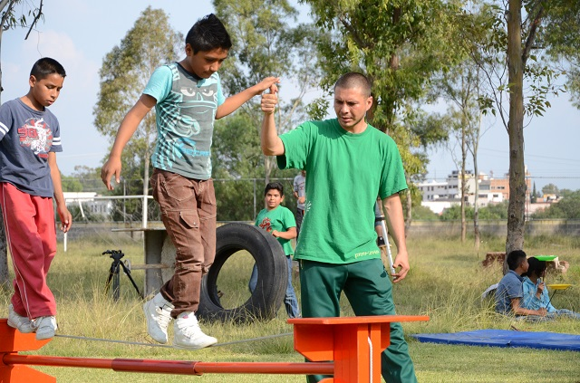 SOS kids learning to walk a tightrope in the SOS Social Circus program