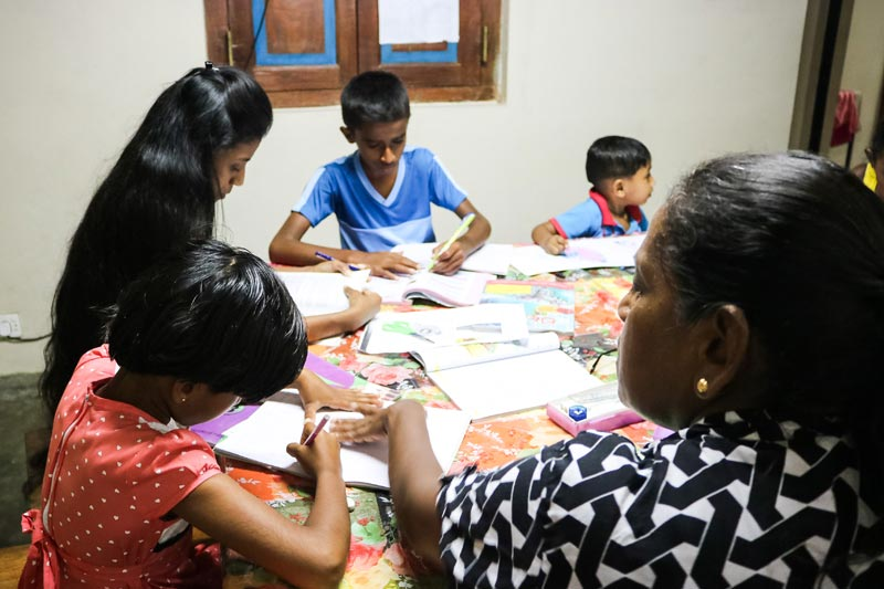 SOS family doing their homework in Sri Lanka