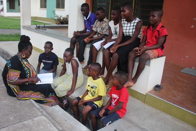 SOS family reading together in Ghana
