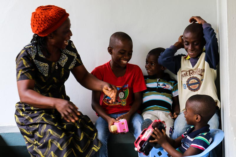 SOS mother and her children laughing in Nigeria