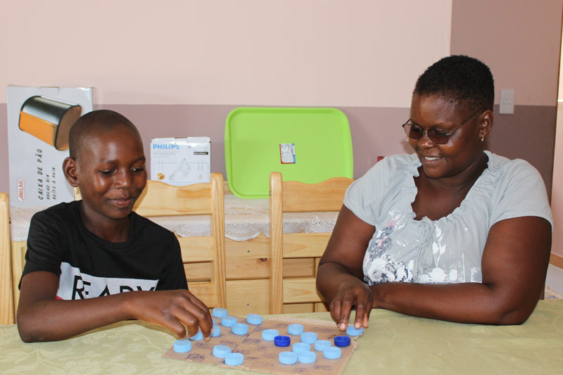 SOS mother Zelia playing a game with her son Edricio
