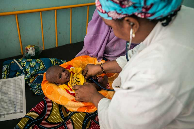 19 day old boy receives check for malnourishment - Diffa, Niger