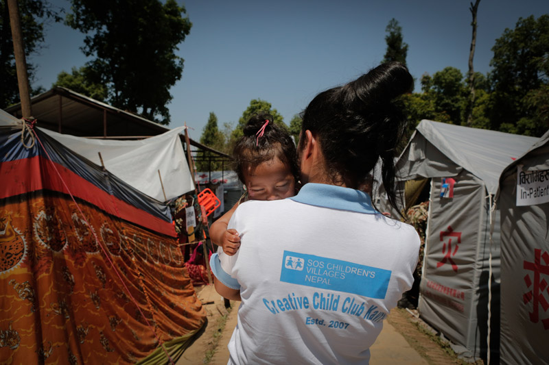 SOS volunteer holding a child in Kavre, Nepal