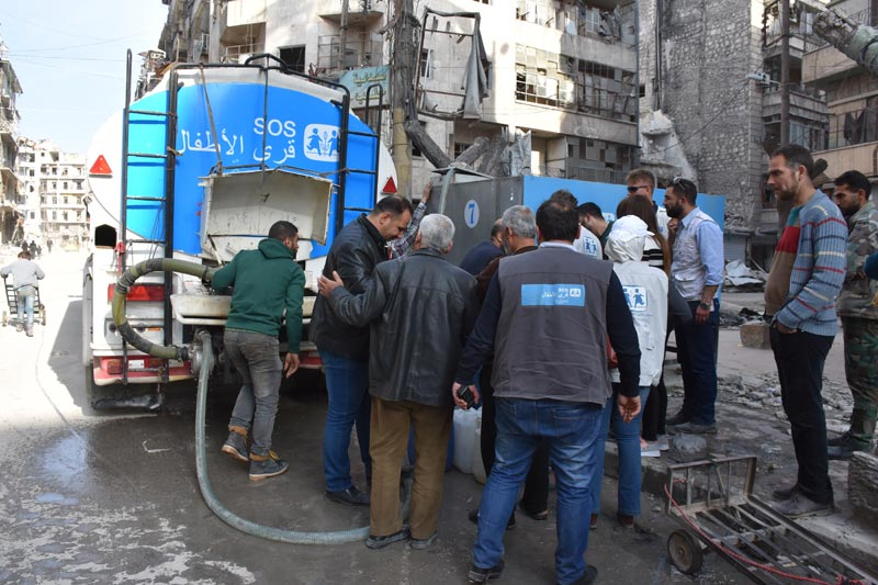 SOS water truck distributin water to residents of Aleppo, Syria