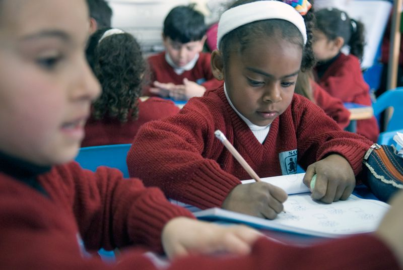 Sponsored students writing in classroom in Bethlehem