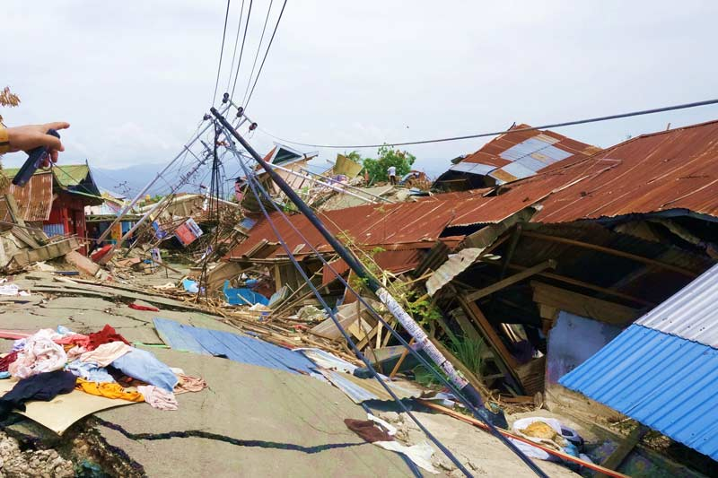 Damaged street and houses from the Indonesian earthquake and tsunami