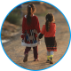 Two young refugee girls holding hands