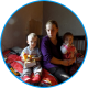 Anastasia with her children in a temporary shelter.