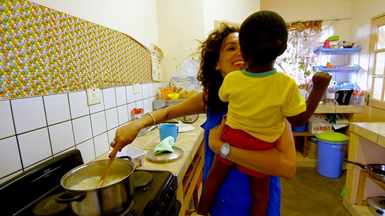 Amanda Martinez cooking a Canadian dinner for the children