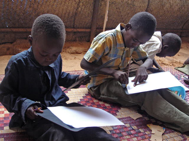 SOS children doing school work in Sudan.