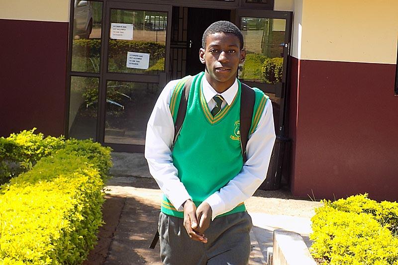 Teenager in school uniform