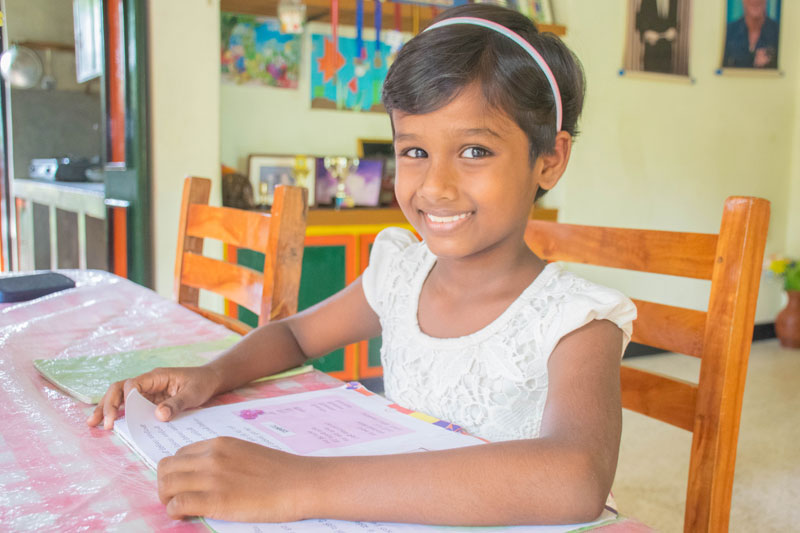 Tharushi working on her school work