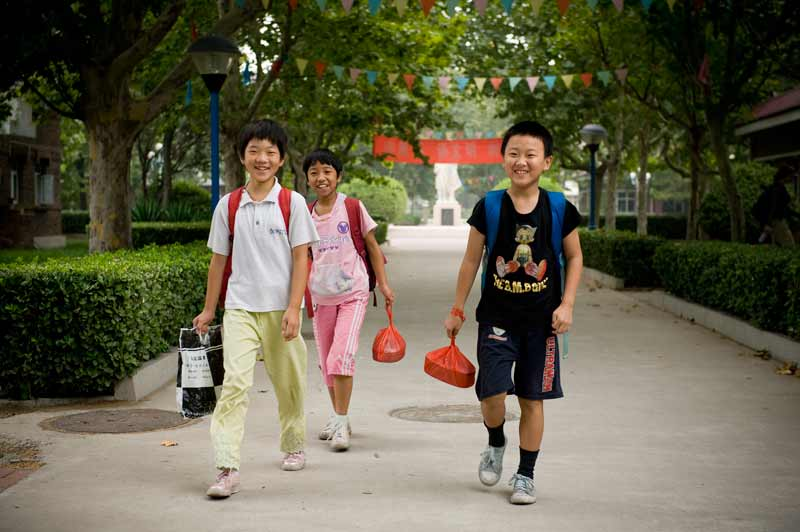 Three sponsored children going to school in China